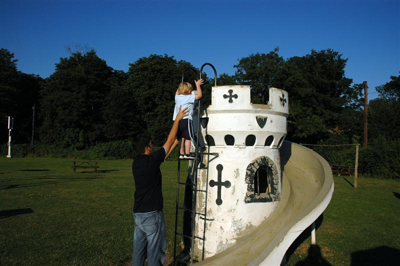 Andrew helps Sam onto the castle slide