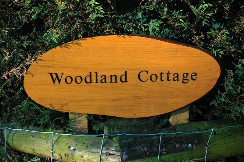 Woodland Cottage sign