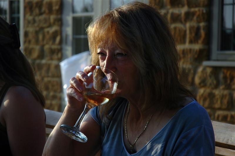 Marianne sips her wine