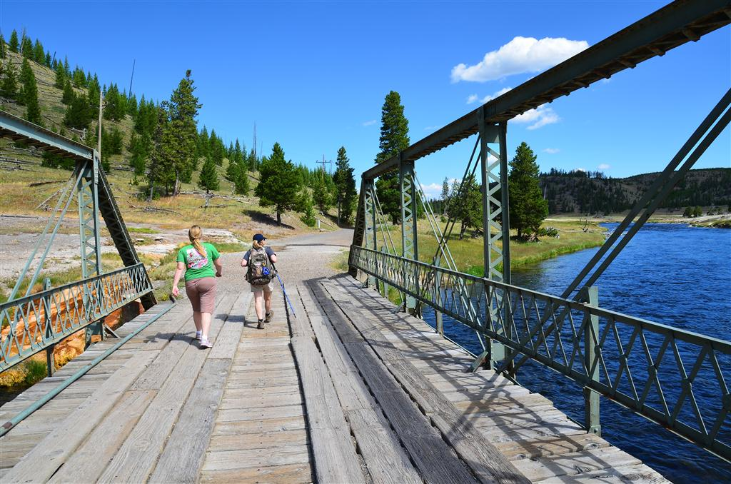 Mel and Kathy cross the trailhead bridge