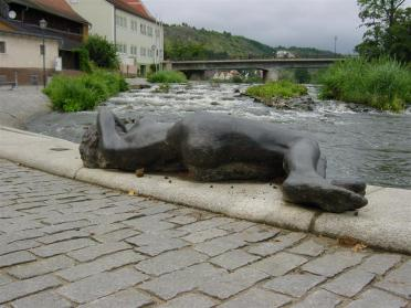 woman-sculpture-and-rapids