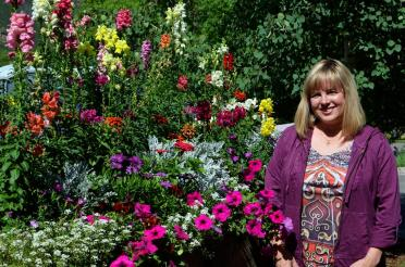 Kathy and flowers at Glenwood gondola