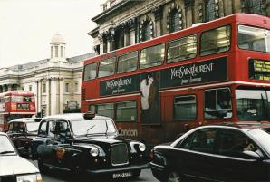 Iconic London traffic - black taxis and double-decker buses