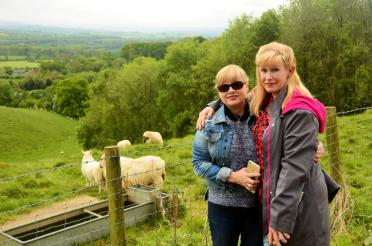 Kathy, LeAnn, and Cotswolds sheep