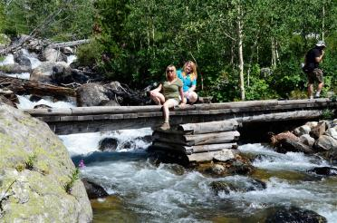 Kathy and Mel over a Teton stream