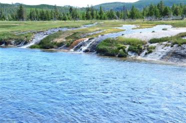 Thermal streams into river at trailhead