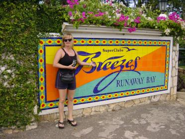 Kathy at the Breezes sign