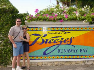 Roger and Kathy at Breezes sign