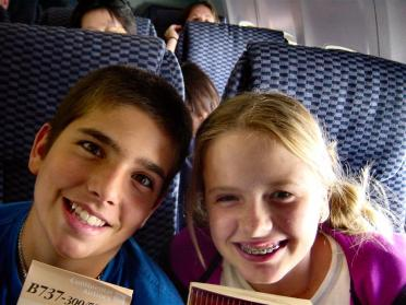 Andrew and Melanie - acting goofy on the plane