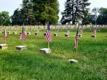 Unknown soldier graves marked with flags